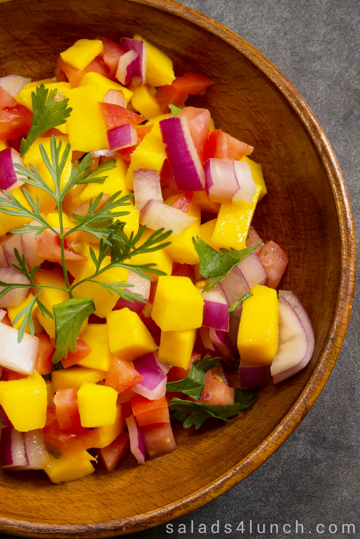 This fresh mango salsa is perfect for entertaining - the juices from theripemango, tomatoes and lime just mingle together, make friends and create a burst of flavours in your mouth. Serve with salmon as a main course or with tortilla chips as an appetizer. #mangosalsa #partyfood #gameday #salsa #healthypartyfood