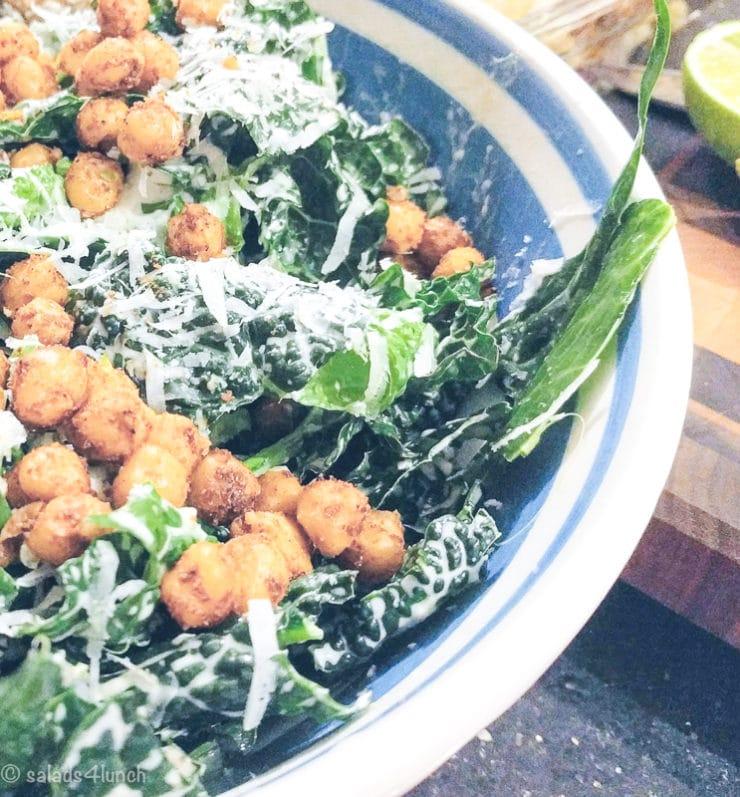 Close shot of a Kale Caesar salad with garlic parmesan chickpea croutons