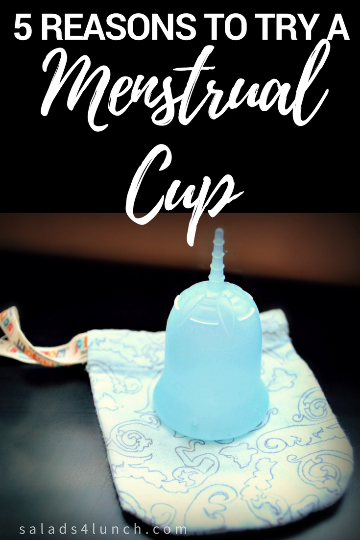 Photo of upside down blue sckooncup menstrual cup on a blue menstrual cup carrying case on a black table with text overlay that says: 5 Reasons to Try a Menstrual Cup..