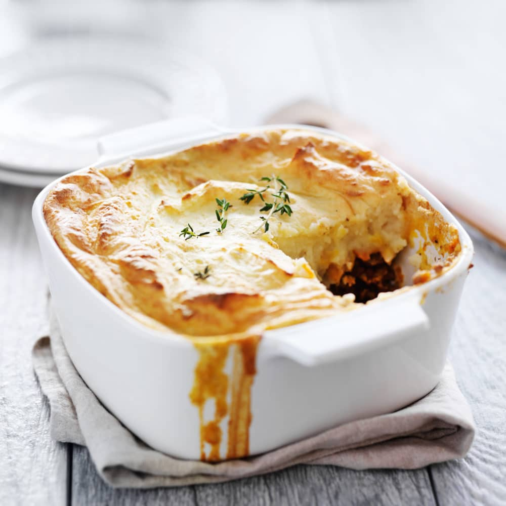 A simple version of the classic meat and vegetable comfort food casserole topped with cheesy garlic mashed potatoes, this is the best Shepherd's Pie recipe you'll ever make! #easyshepherdspie #casserole #gluten-free #groundbeef