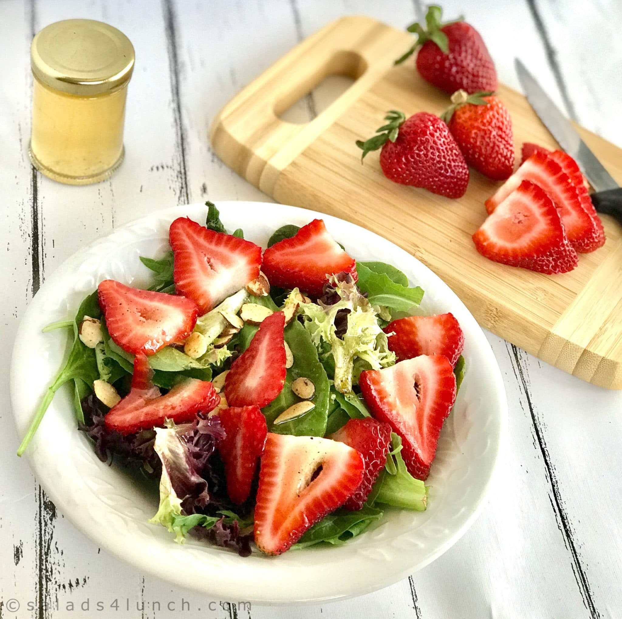 Honey Vinaigrette Salad Dressing. An easy formula for this salad dressing that you can customize to your taste buds. Tangy, sweet, and delicious! #summersalad #saladdressing #strawberrysalad #honeyvinagrette #healthysalad