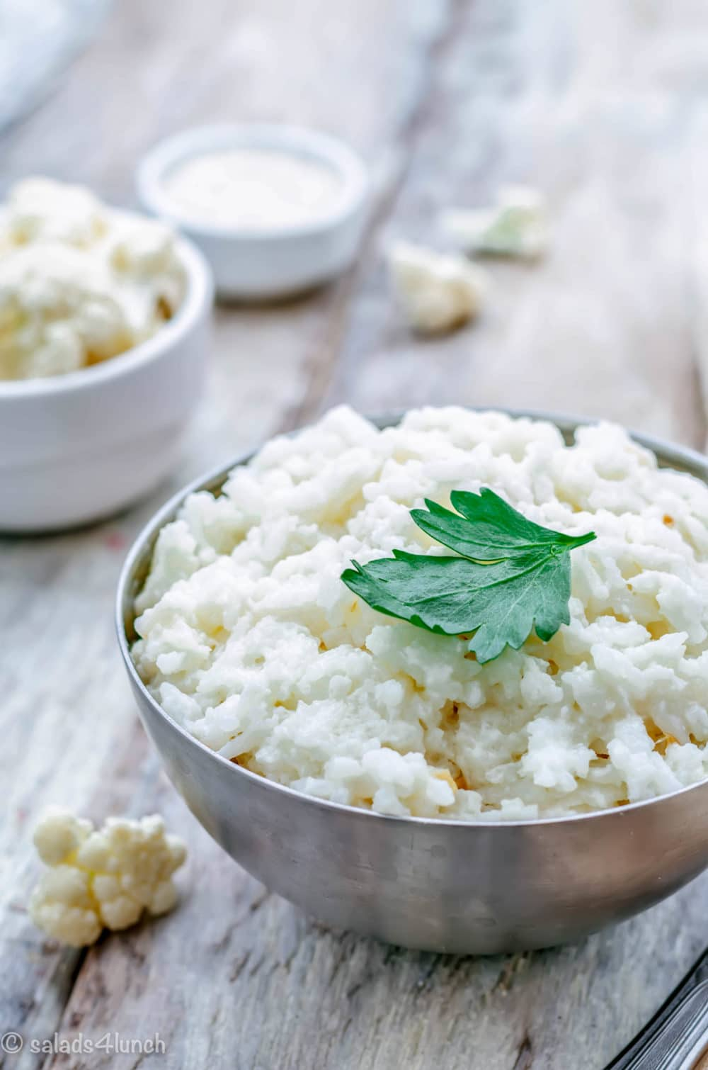 Garlic Parmesan Cauliflower Rice goes with almost everything from steak to chicken, to lean turkey meatballs. It's super flavourful with lots of olive oil, garlic, parmesan, fresh parsley and salt and black pepper.