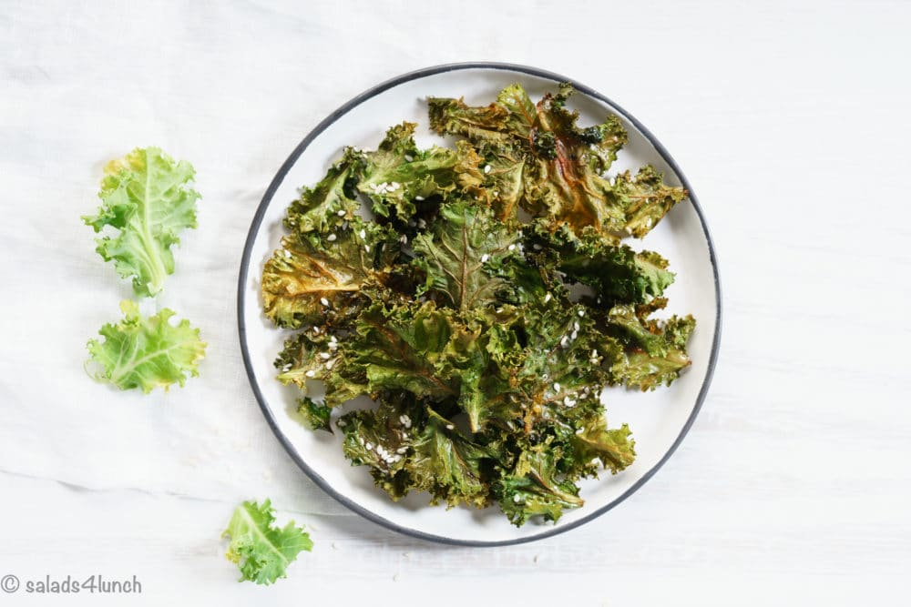 You won't be able to get enough of these yummy Oven Roasted Kale Chips!  Healthy, Easy, and SO delicious!