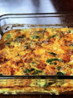 Meal Prep Keto Sausage, Egg, and Spinach Breakfast Casserole is the perfect quick and easy make-ahead, meal prep dish with cheese, sauteed onions, and peppers. This dish is keto friendly and perfect for keto diets. Serve this dish for your holiday breakfasts and brunch! #KetoBreakfast #KetoFriendly #BreakfastCasserole #MealPrep #MealPrepBreakfast #MealPrepCasserole #HealthyBreakfast