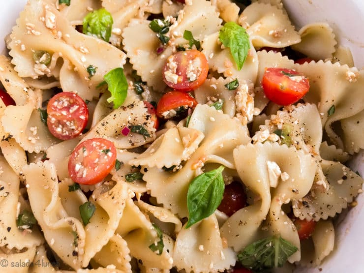 This quick and easy Feta Bruschetta Pasta Salad packs bold flavours to stand up to your summer grilling feasts and is sure to be a hit at your next BBQ or cookout.