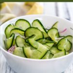White bowl spiralized cucmber salad