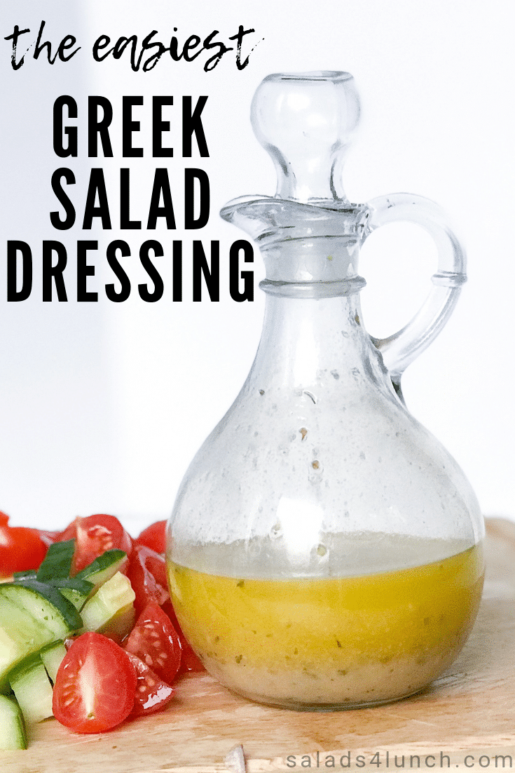 Photo of greek salad dressing in glass jar with tomatoes and cucmbers