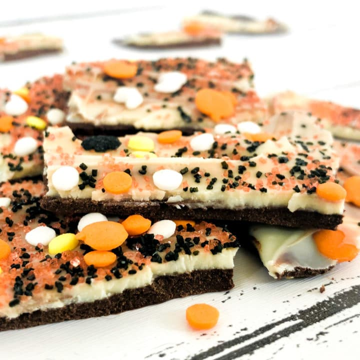 Pinterest image for Halloween Chocolate Bark - This Double Chocolate Halloween Bark recipe only takes minutes to make and is so easy that even your kids can make it. Use your imagination and make it as spooky as you want!
