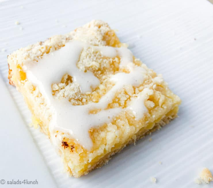 Single pineapple square on a white plate