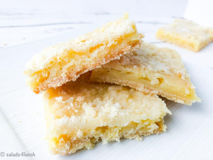 Three pineapple squares on a white plate