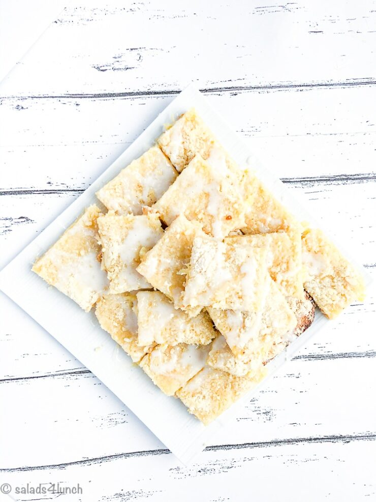 White plate with tower of easy hawiian pineapple squares