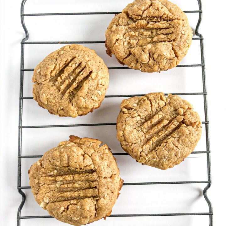 Peanut Butter Oatmeal cookies cooling on a rack with white backgrund