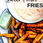 Plate of delicious sweet potato fries made in the air fryer with a bowl of chipotle may in the background, text overlay on the photo says: Air fryer sweet potato fries