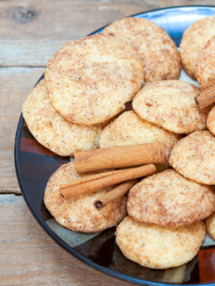 Plate of Snickerdoodle cookies with cinnamon sugar topping.
