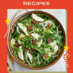 Image of apple pecan salad on a red background with text overlay that says Thirteen Christmas Salad Recipes.