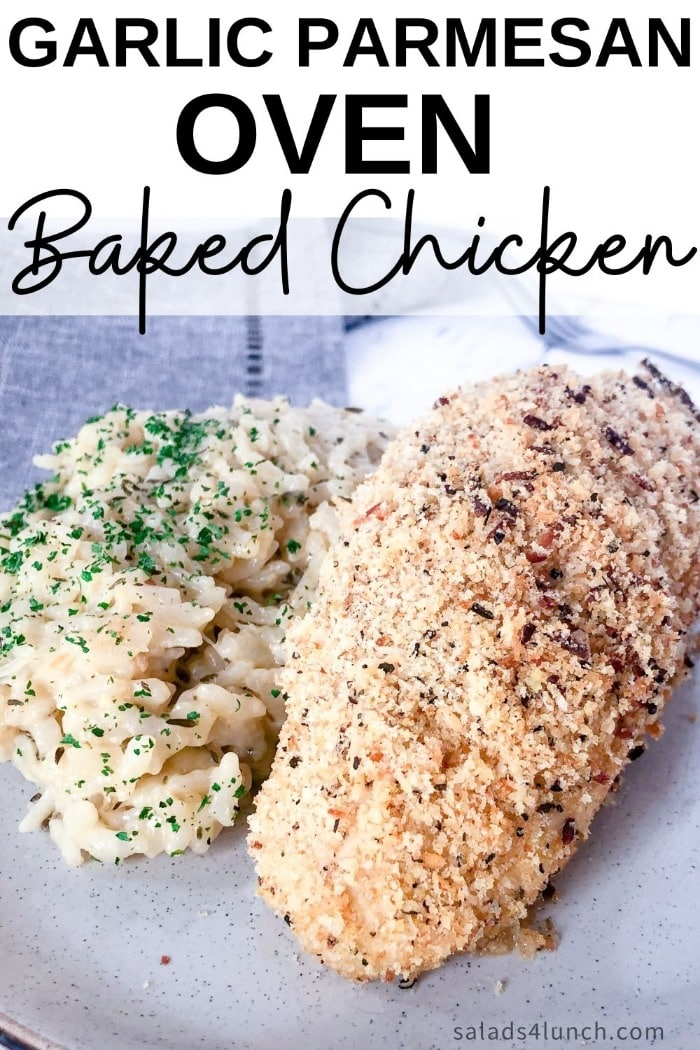 "Close up of garlic parmesan baked chicken breast with a side of risotto on a white plate on a grey napkin with text overlay that says ""Garlic Parmesan Oven Baked Chicken""."