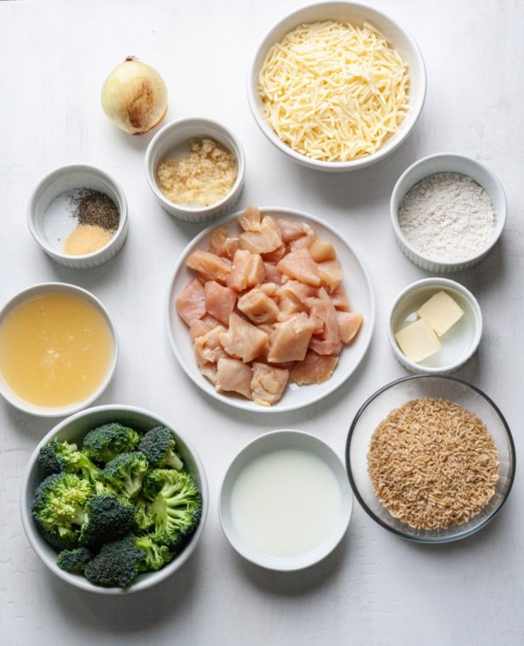 Photo of ingredients for Easy Instant Pot Chicken Broccoli and Rice Casserole in small white ramekins