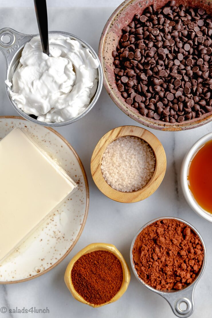 Ingredients for vegan chocolate protein pudding: Silken tofu, semi sweet chocolate chips, cocoa powder, coconut cream, maple syrup, instant coffee, salt.